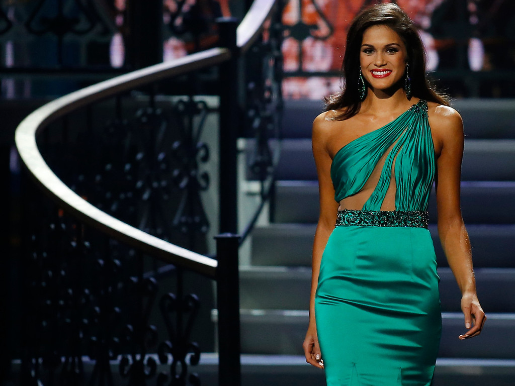 . Runner-up Miss North Dakota USA Audra Mari participates in the evening gown competition during the Miss USA pageant in Baton Rouge, La., Sunday, June 8, 2014. (AP Photo/Jonathan Bachman)