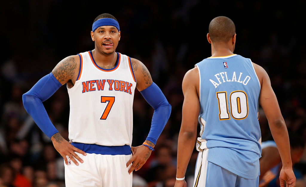 . New York Knicks forward Carmelo Anthony   (7) reacts as Denver Nuggets guard Arron Afflalo (10) walks away in the second half of an NBA basketball game in New York, Sunday, Nov. 16, 2014. The Knicks defeated the Nuggets 109-93. (AP Photo/Kathy Willens)