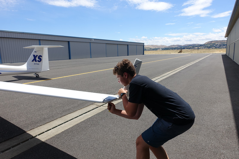 Ethan puts on a winglet during assembly of the Ximango.
