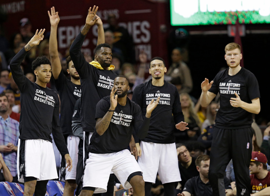 . The San Antonio Spurs bench celebrates during overtime in an NBA basketball game against the Cleveland Cavaliers, Saturday, Jan. 21, 2017, in Cleveland. The Spurs won 118-115. (AP Photo/Tony Dejak)