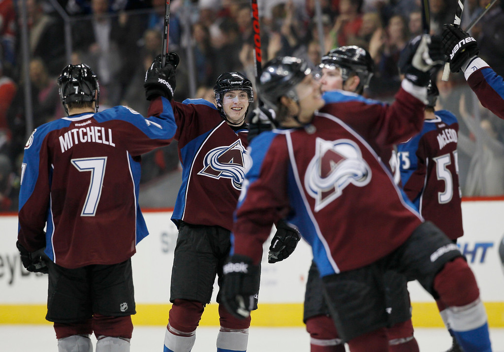 . Colorado Avalanche center John Mitchell, left, congratulates center Matt Duchene, second from left, as members of the Aalanche celebrate a 6-2 victory over the Chicago Blackhawks in an NHL hockey game in Denver on Friday, March 8, 2013. Chicago\'s loss was the first for the team in regulation this season. (AP Photo/David Zalubowski)