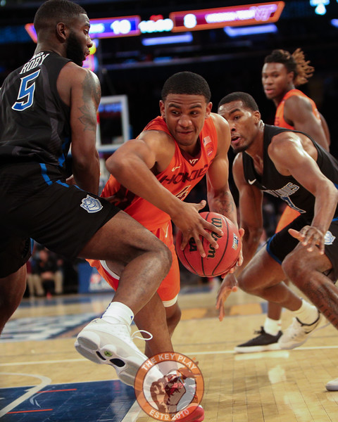 Virginia Tech's guard Nickeil Alexander-Walker (4) ducks around St. Louis' guard Davell Roby (5) in Madison Square Garde, Nov. 16, 2017. St. Louis upset Virginia Tech with a 77-71 win.