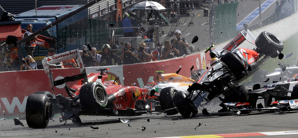 . In this Sept. 2, 2012 file photo, Ferrari driver Fernando Alonso of Spain, left, crashes with McLaren Mercedes driver Lewis Hamilton of Britain, airborne right,  during the first lap of the Belgium Formula One Grand Prix in Spa-Francorchamps circuit, Belgium. (AP Photo/Luca Bruno, File)