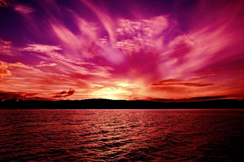 Magenta rays Ocean Sunset. Australia