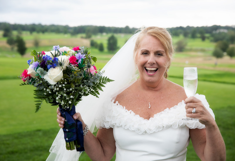 Bride with Bouquet and Champaigne.jpg