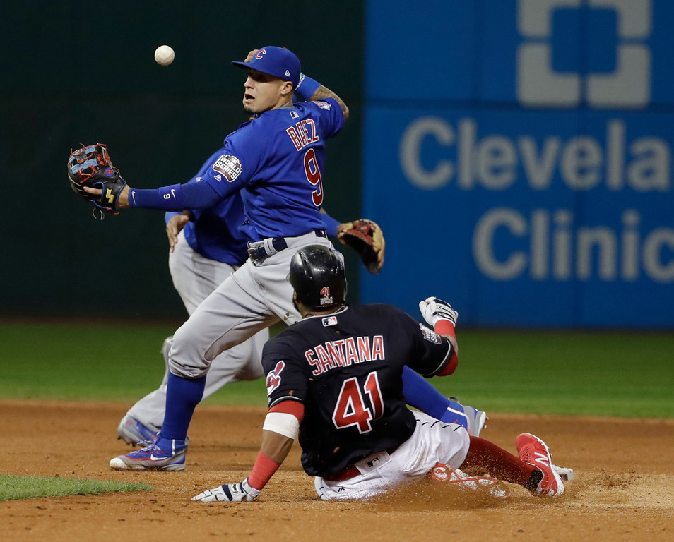 . Chicago Cubs\' Javier Baez can\'t handle the ball as Cleveland Indians\' Carlos Santana slides safely into second during the third inning of Game 7 of the Major League Baseball World Series Wednesday, Nov. 2, 2016, in Cleveland. (AP Photo/David J. Phillip)