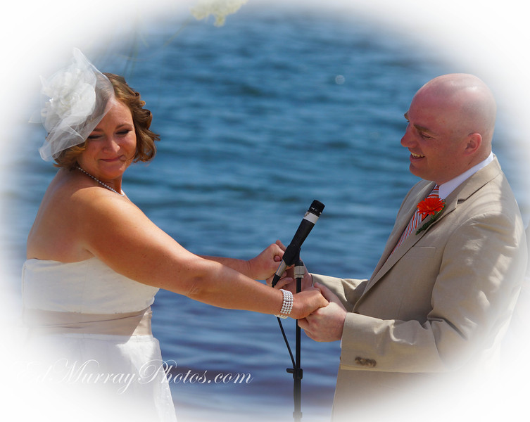 Their Big Day: Here's the happy couple during their wedding ceremony. More to come tomorrow! Happy Tuesday!  6/18/2013