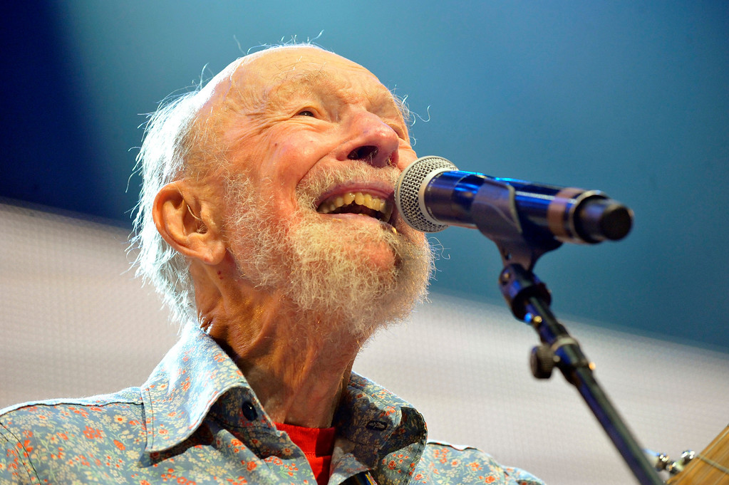 . File-This Sept. 21, 2013, file photo shows Pete Seeger performing on stage during the Farm Aid 2013 concert at Saratoga Performing Arts Center in Saratoga Springs, N.Y.   The American troubadour, folk singer and activist Seeger  died Monday Jan. 27, 2014, at age 94.  (AP Photo/Hans Pennink, File)