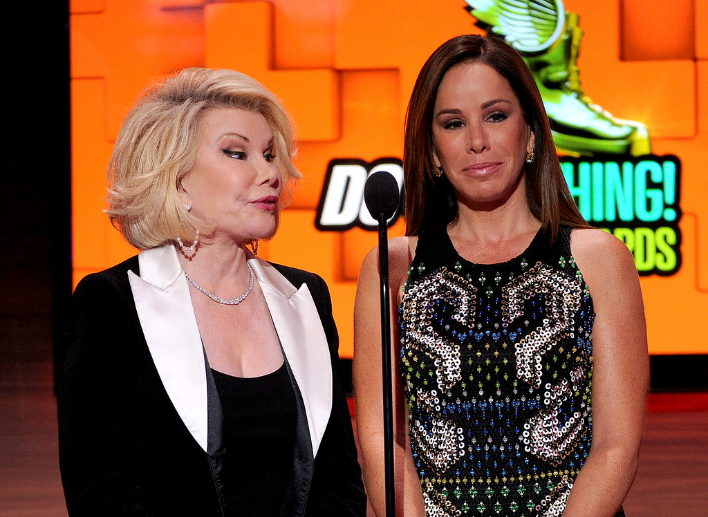 . From left, presenters Joan Rivers and Melissa Rivers are seen onstage at the 2013 Do Something Awards, on Wednesday, July 31, 2013 in Hollywood, Calif. (Photo by Frank Micelotta/Invision/AP Images)