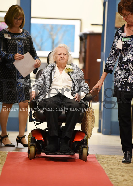 Harold Aughton/Butler Eagle: Emma Nesbill, 104, makes her way down the red carpet during the Celebrating Life Centenarian Celebration at Concordia Lutheran Services in Zelienople Friday, Sept. 27.