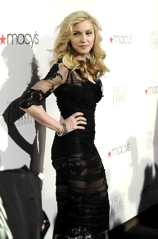 """. Singer Madonna arrives at Macy\'s Herald Square to launch her new fragrance \""""Truth or Dare By Madonna\"""" on Thursday, April 12, 2012 in New York.  (AP Photo/Evan Agostini)"""