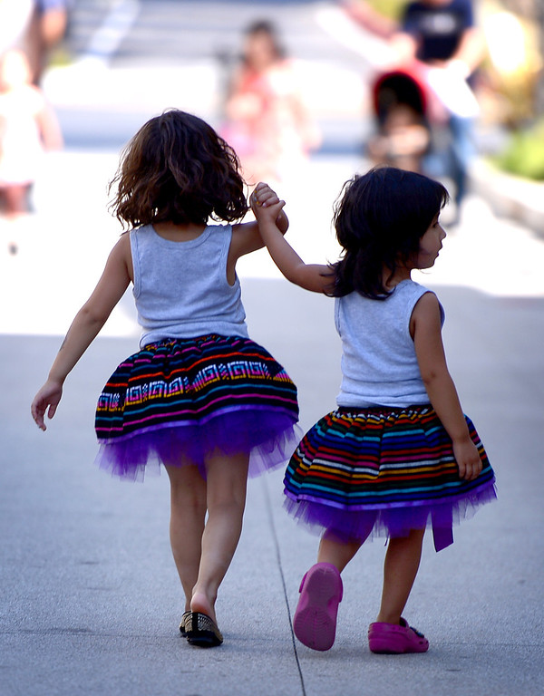 . Alicia Sosa, 4, of Whittier, and her sister Valentina, 3, leave Rio Hondo College\'s Latino Heritage Month\'s kickoff celebration Saturday, September 14, 2013. (Photo by Sarah Reingewirtz/Pasadena Star-News)