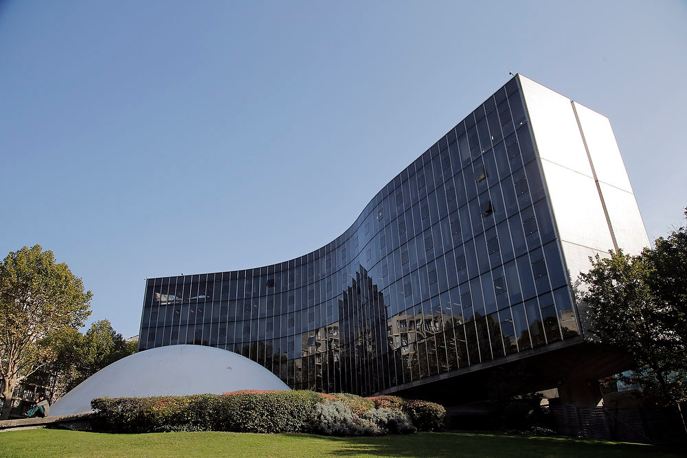 Description of . This Oct. 22, 2012 photo shows the headquarters of French Communist Party, designed by Brazilian architect Oscar Niemeyer, in Paris. According to a hospital spokeswoman on Wednesday, Dec. 5, 2012, famed Brazilian architect Oscar Niemeyer has died at age 104. (AP Photo/Christophe Ena)