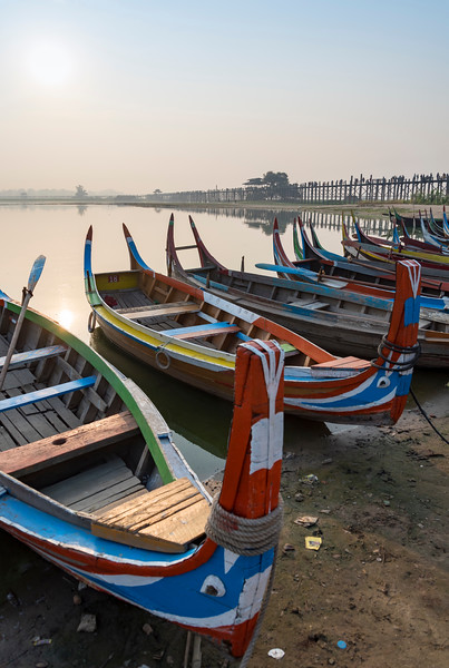 Fishing boats near the U Bein Bridge across the Taungthaman Lake in Amarapura near Mandalay, Burma (Myanmar)