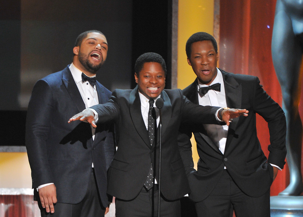 . O\'Shea Jackson, from left, Jason Mitchell, and Corey Hawkins introduce their film, ìStraightî Outta Comptonî, nominated for best cast in a motion picture at the 22nd annual Screen Actors Guild Awards at the Shrine Auditorium & Expo Hall on Saturday, Jan. 30, 2016, in Los Angeles. (Photo by Vince Bucci/Invision/AP)