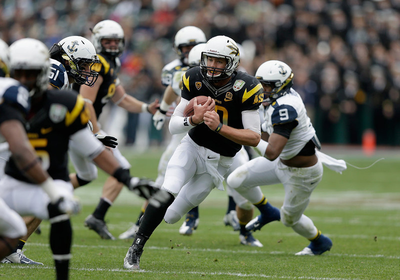 . Taylor Kelly #10 of the Arizona State Sun Devils runs with the ball during the Kraft Fight Hunger Bowl against the Navy Midshipmen at AT&T Park on December 29, 2012 in San Francisco, California.  (Photo by Ezra Shaw/Getty Images)