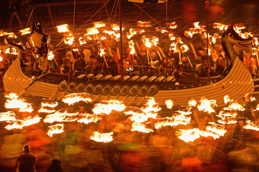 . The Jarl Squad march around a Viking Longship before torching it on January 28, 2014, in the Shetland Islands, Scotland. The traditional festival of fire is known as \'Up Helly Aa\'. The spectacular event takes place annually on the last Tuesday of January. The climax of the day comes with participants in full costume hauling a Viking longboat through the streets of Lerwick to the edge of town where up to 1000 paraders will throw their flaming torches into the galley.  (Photo by Jeff J Mitchell/Getty Images)