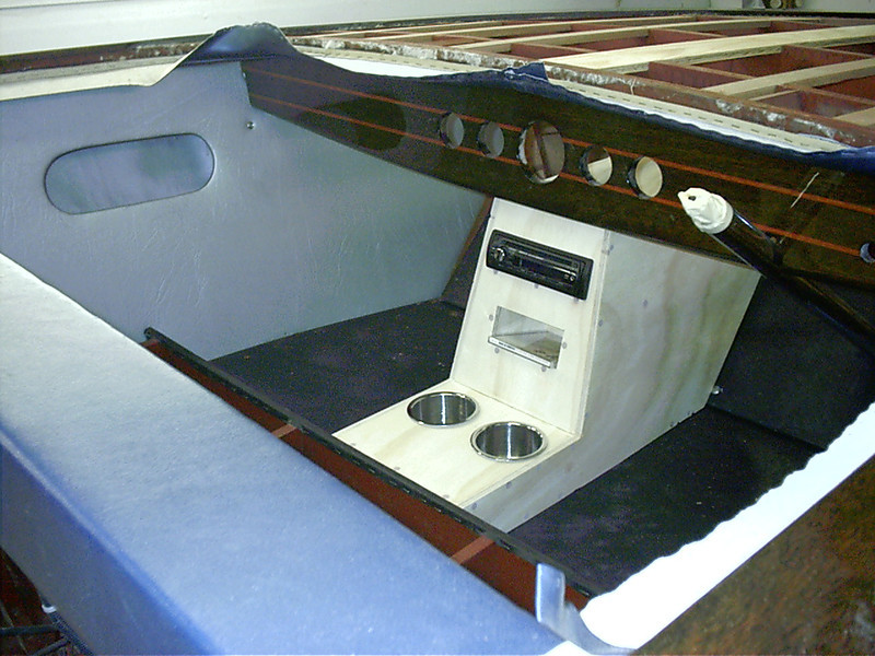 Starboard view of the console with radio, cd storage and drink holders before being covered with mahogany.