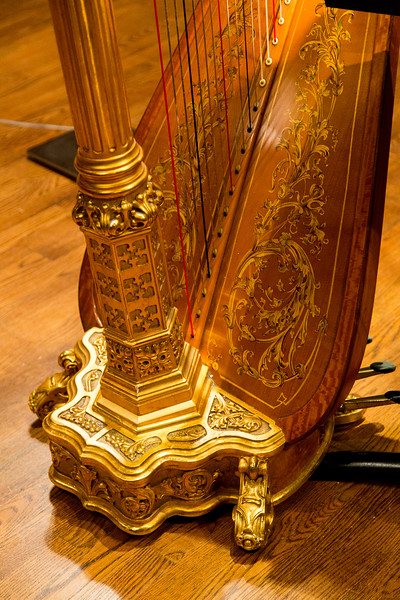 Harp base with elaborate decor