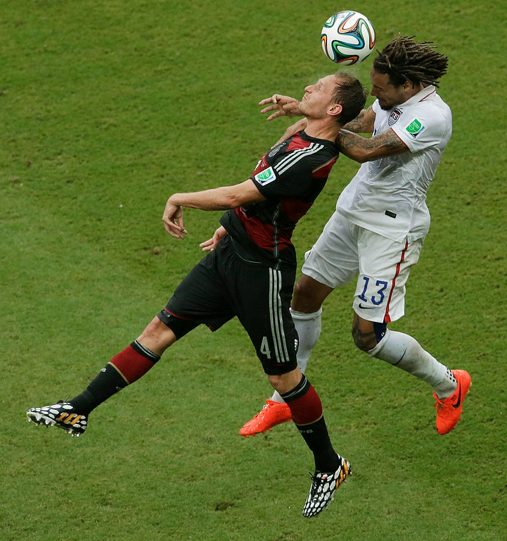 . Germany\'s Benedikt Hoewedes and United States\' Jermaine Jones go for a header during the group G World Cup soccer match between the USA and Germany at the Arena Pernambuco in Recife, Brazil, Thursday, June 26, 2014. (AP Photo/Hassan Ammar)