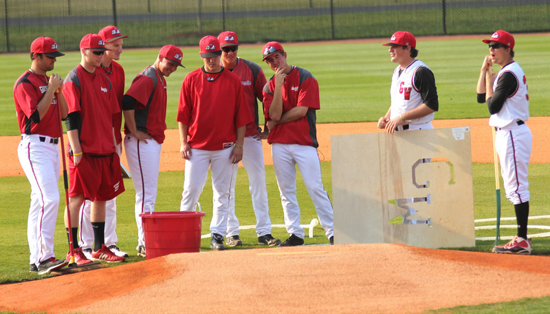 A host of GWU players prepare the field before the game against Charleston Southern.