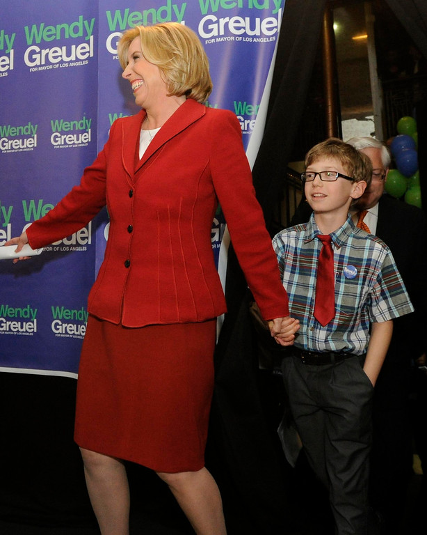 . Wendy Greuel enters the stage with her 9-year-old son Thomas Schramm. Greuel held her election night party at the Los Angeles Brewing Company in downtown Los Angeles, CA 3/5/2013(John McCoy/Staff Photographer)