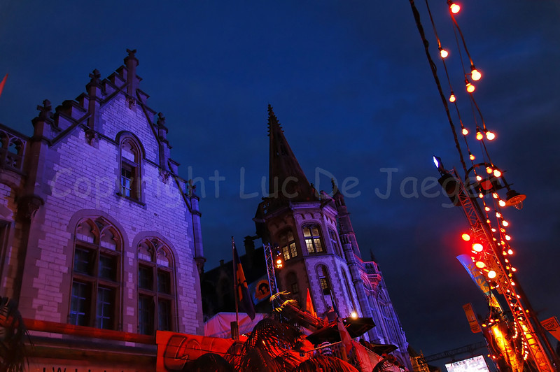 The highly colorful Polé Polé Festival during the Ghent Festivities (Gentse Feesten) 2009 in Ghent (Gent), Belgium is one of the many attractions bringing thousands of people to the place between Graslei and Korenlei. Photo captured at night.