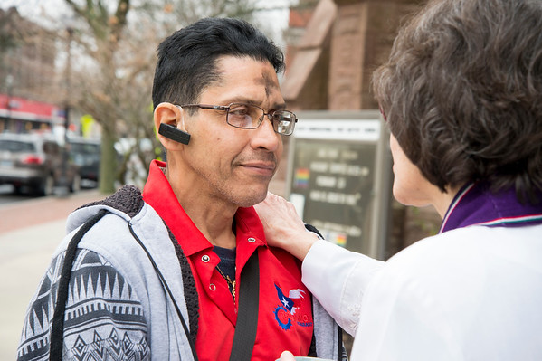 02/26/20 Wesley Bunnell | StaffrrPastor Jane Rowe from South Congregational Church stood outside of the church on Ash Wednesday for anyone that wanted to receive ashes. She is shown here with Juan Ortiz receiving the ashes.