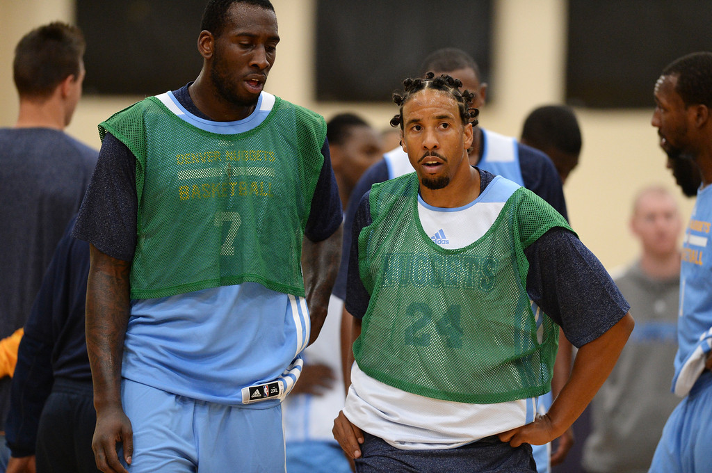 . JJ Hickson (7), Andre Miller (24) and the Denver Nuggets take the court for their first official practice under new coach Brian Shaw at Pepsi Center. Denver, Colorado. October 1, 2013. (Photo by Hyoung Chang/The Denver Post)