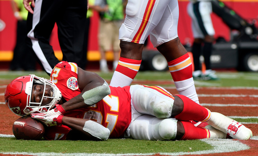 . Kansas City Chiefs running back Kareem Hunt (27) pretends to sleep on the ball as he celebrates a touchdown during the second half of an NFL football game against the Philadelphia Eagles in Kansas City, Mo., Sunday, Sept. 17, 2017. (AP Photo/Ed Zurga)