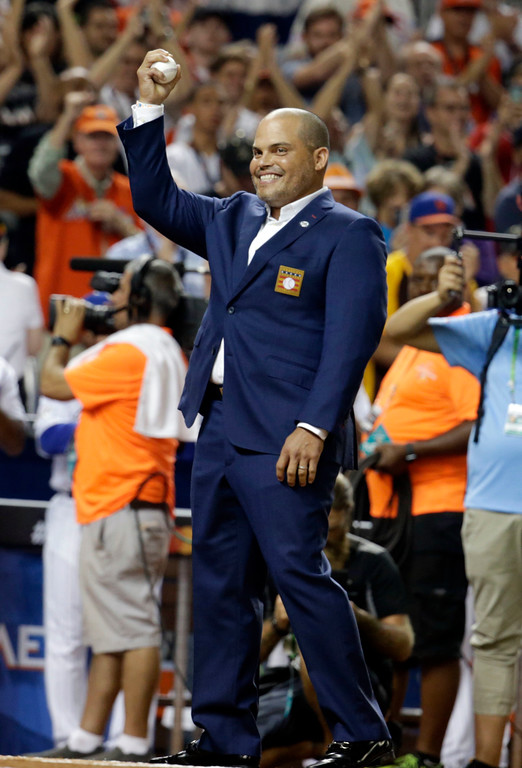 . Player Ivan Rodriguez gets ready to throw the ceremonial first pitch before the MLB baseball All-Star Game, Tuesday, July 11, 2017, in Miami. (AP Photo/Lynne Sladky)