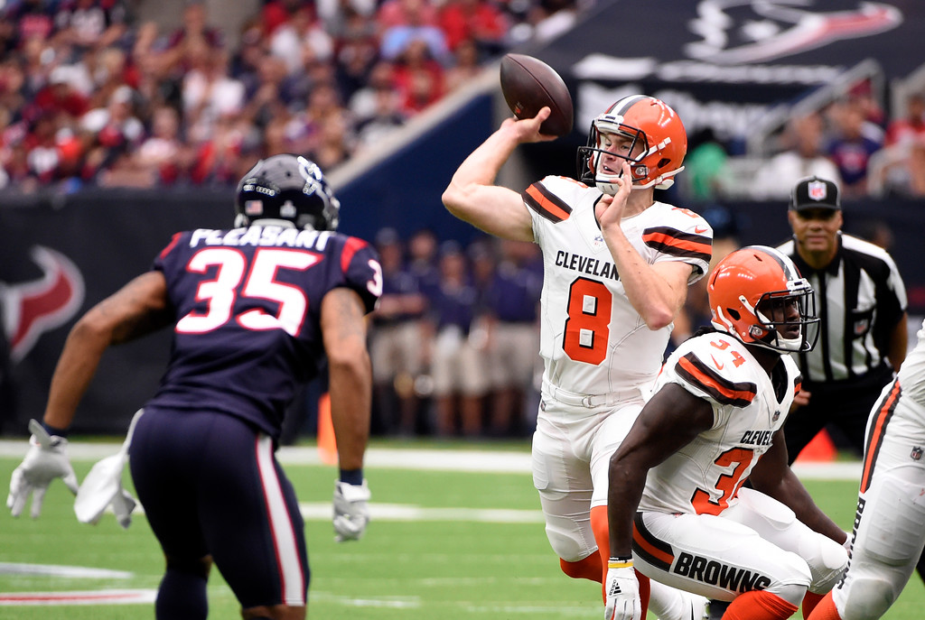 . Houston Texans safety Eddie Pleasant (35) pressures as Cleveland Browns quarterback Kevin Hogan (8) throws a pass in the first half of an NFL football game, Sunday, Oct. 15, 2017, in Houston. (AP Photo/Eric Christian Smith)