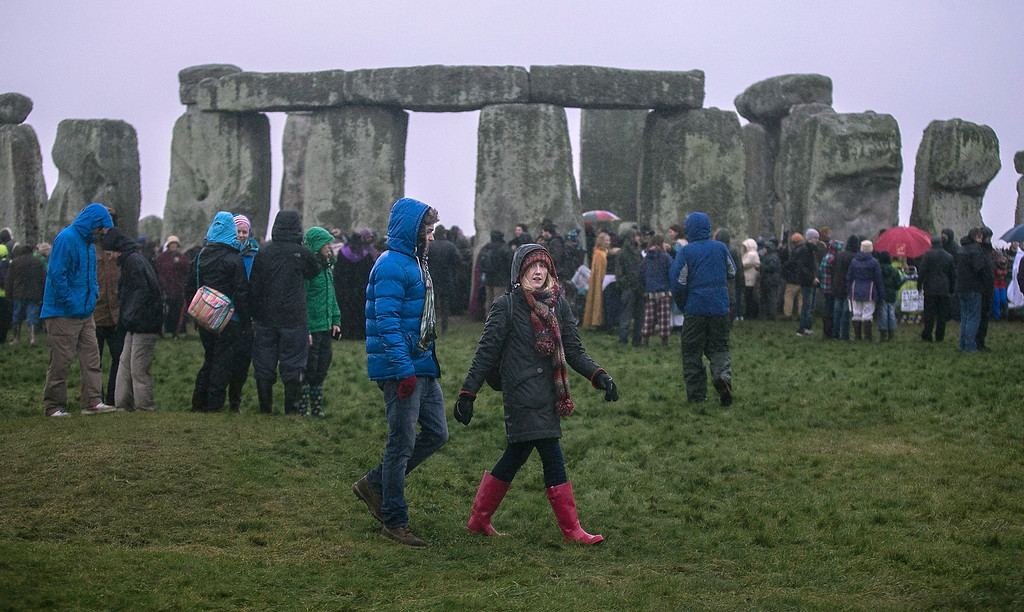 . Rain falls as druids, pagans and revellers gather at Stonehenge, hoping to see the sun rise, as they take part in a winter solstice ceremony at Stonehenge on December 21, 2013 in Wiltshire, England.  (Photo by Matt Cardy/Getty Images)