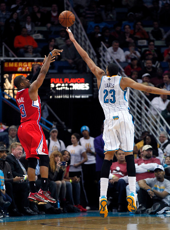 . Los Angeles Clippers point guard Chris Paul (3) shoots over New Orleans Hornets power forward Anthony Davis (23) in the second half of an NBA basketball game in New Orleans, Wednesday, March 27, 2013. The Clippers won 105-91.  Paul added 16 points and nine assists. (AP Photo/Gerald Herbert)