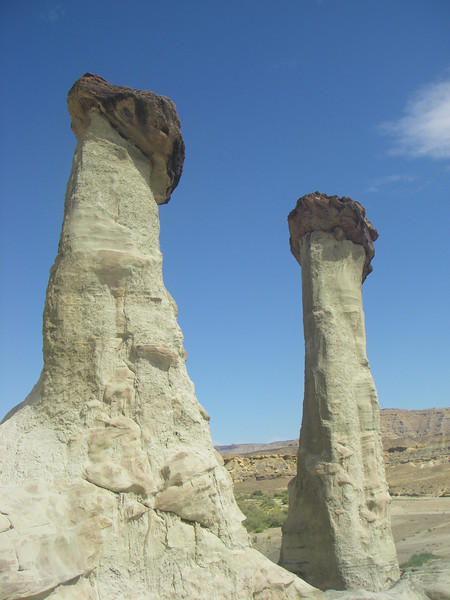 The towering white columns of Entrada sandstone have brown cups of Dakota Sandstone.