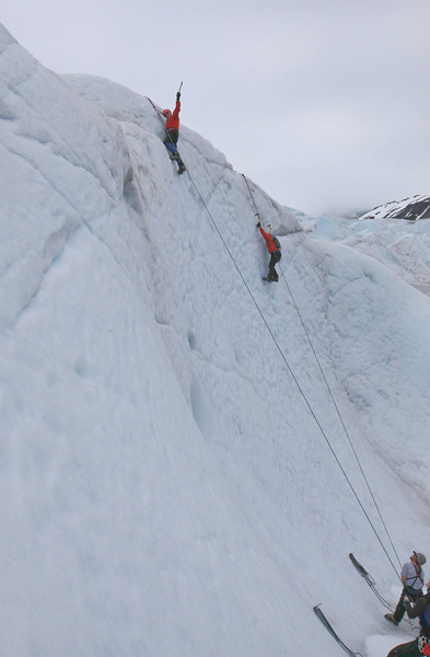 Bob raising his ice pick at the top of the climb