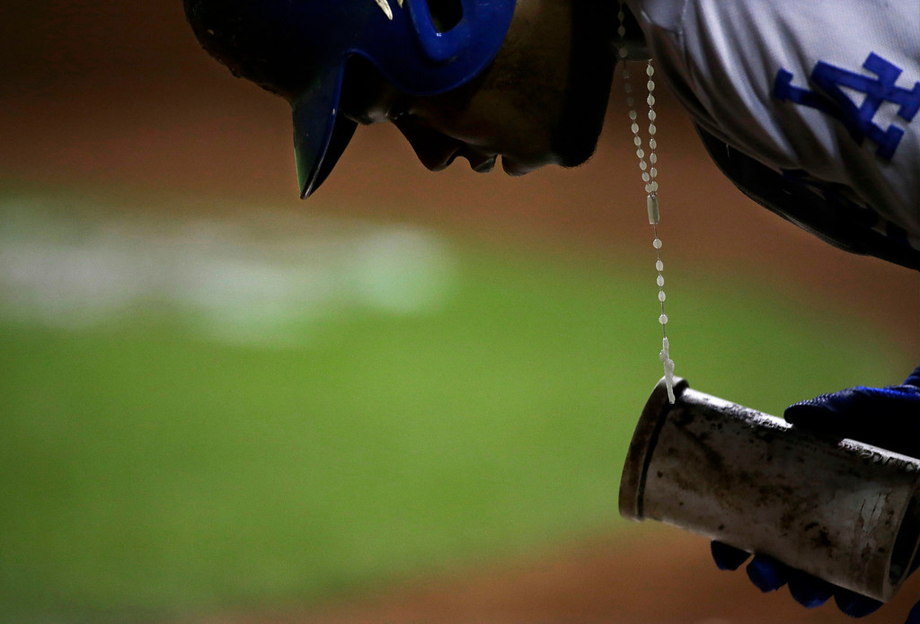 . Los Angeles Dodgers\' Hanley Ramirez gets ready to bat during the second inning of Game 6 of the National League baseball championship series against the St. Louis Cardinals, Friday, Oct. 18, 2013, in St. Louis. (AP Photo/David J. Phillip)