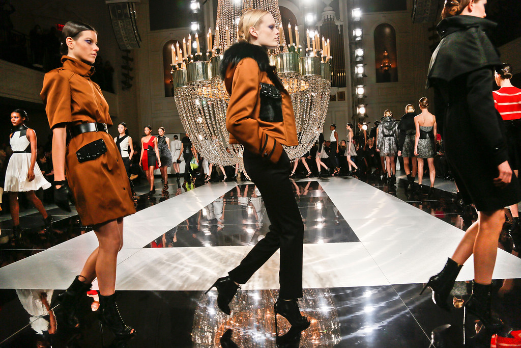 . Fashion from the Fall 2013 collection of Jason Wu is modeled on Friday, Feb. 8, 2013 in New York.  (AP Photo/Bebeto Matthews)