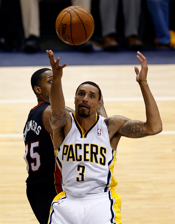 . INDIANAPOLIS, IN - MAY 28: George Hill #3 of the Indiana Pacers loses the ball as Mario Chalmers #15 of the Miami Heat defends during Game Five of the Eastern Conference Finals of the 2014 NBA Playoffs at Bankers Life Fieldhouse on May 28, 2014 in Indianapolis, Indiana.  (Photo by Joe Robbins/Getty Images)