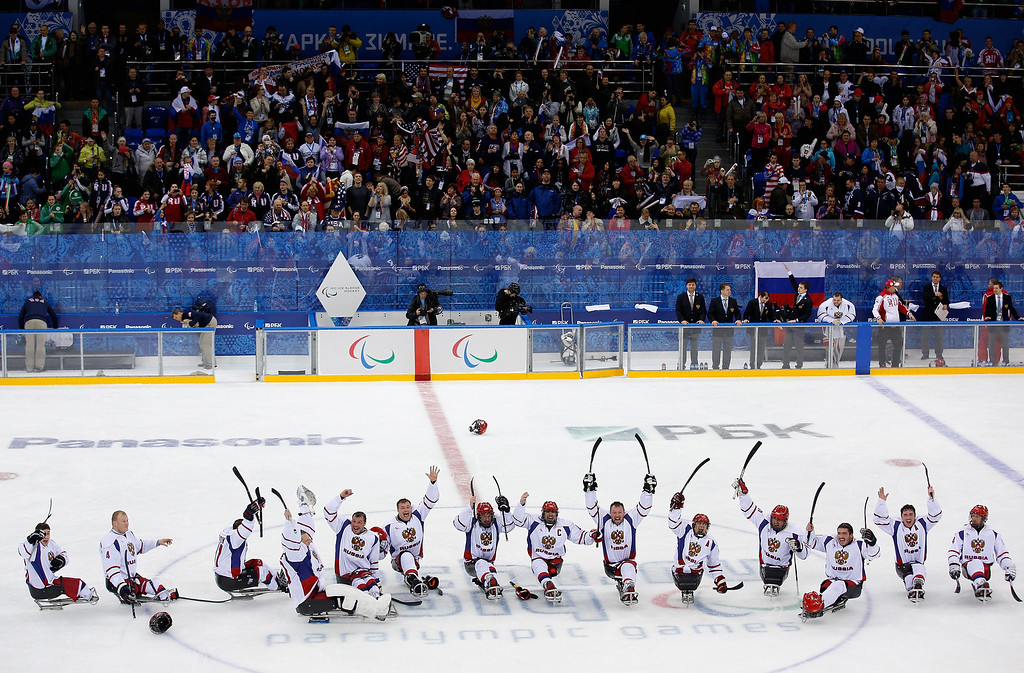. The Russian team celebrate victory during the Ice Sledge Hockey Preliminary Round Group B match between USA and Russia at the Shayba Arena during day four of the Sochi 2014 Paralympic Winter Games on March 11, 2014 in Sochi, Russia.  (Photo by Harry Engels/Getty Images)