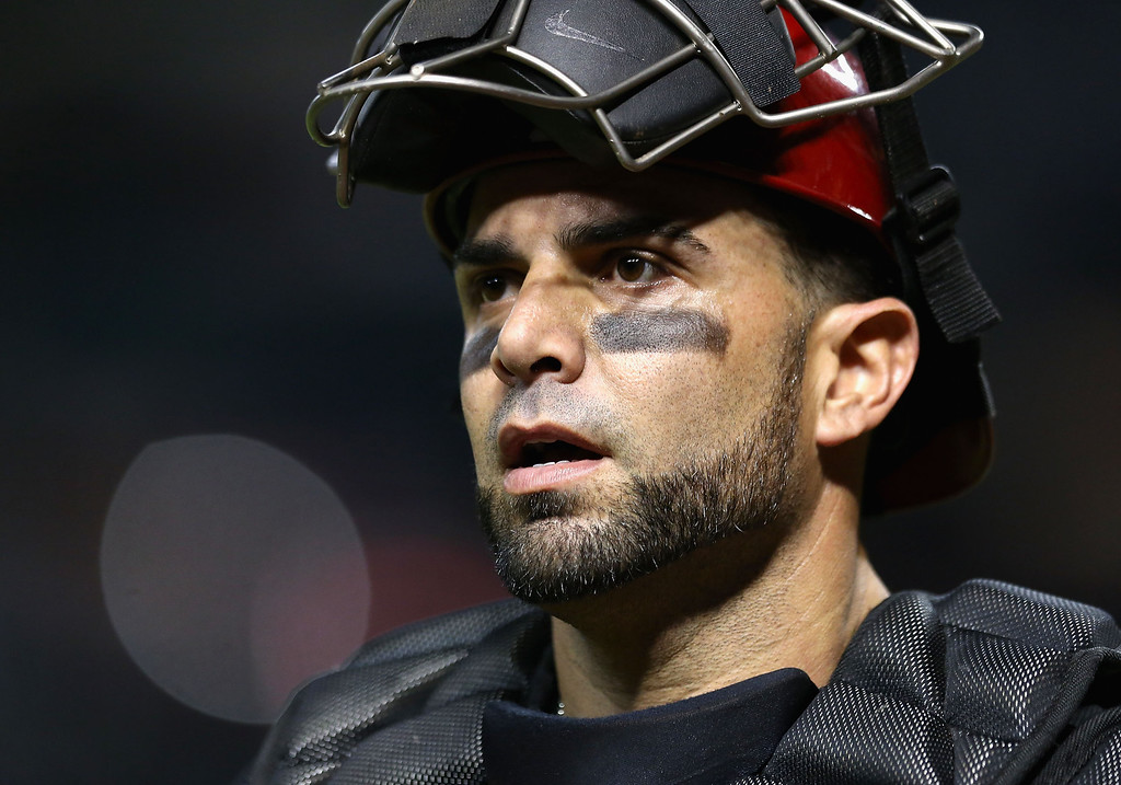 . PHOENIX, AZ - JULY 10:  Catcher Wil Nieves #27 of the Arizona Diamondbacks walks back to the dugout during the MLB game against the Los Angeles Dodgers at Chase Field on July 10, 2013 in Phoenix, Arizona.  (Photo by Christian Petersen/Getty Images)