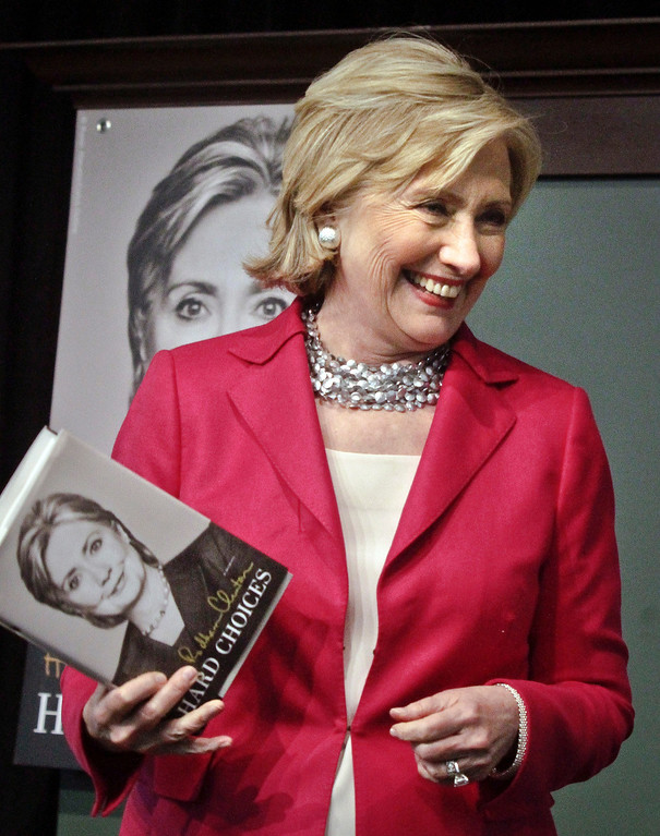. HiIlary Rodham Clinton reacts to cheers as she arrives for a book signing on Tuesday June 10, 2014, at Barnes and Noble bookstore in New York.   (AP Photo/Bebeto Matthews)