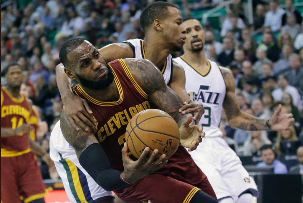 . Utah Jazz guard Rodney Hood, rear, fouls Cleveland Cavaliers forward LeBron James, left, as he goes to the basket in the first half during an NBA basketball game Tuesday, Jan. 10, 2017, in Salt Lake City. (AP Photo/Rick Bowmer)