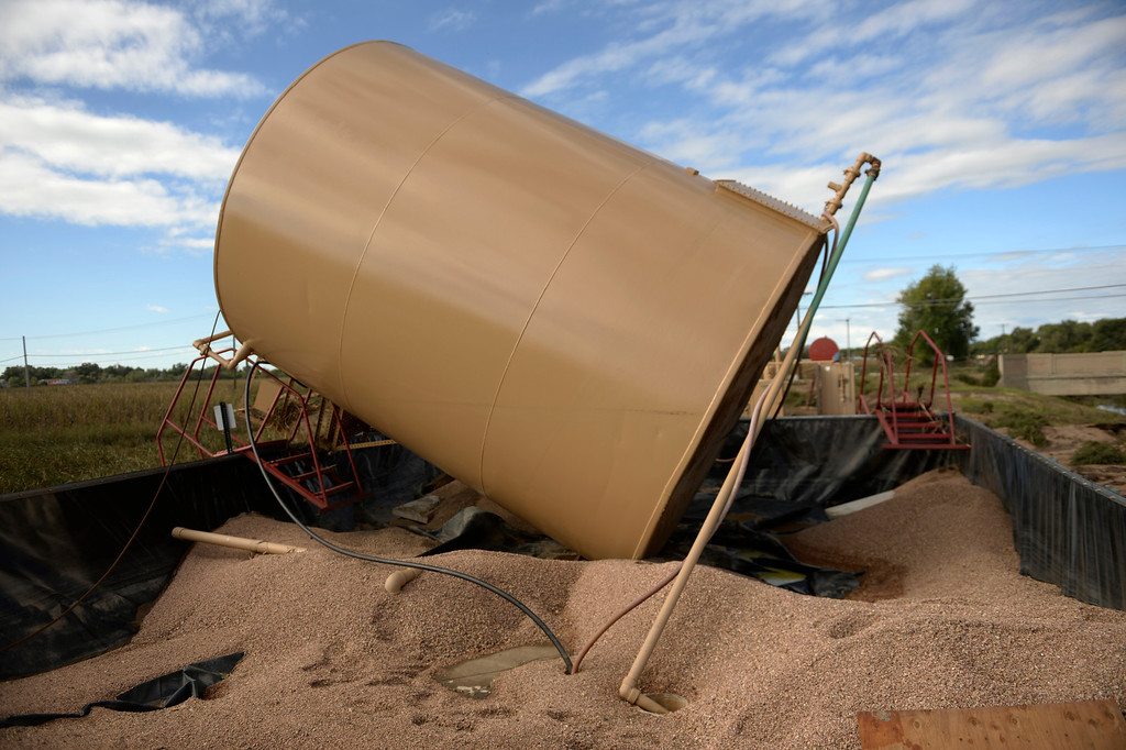 . LASALLE, CO - SEPTEMBER 19: A tank at a gas well is turned on its side due to the flood, September 19, 2013. A massive flood recently hit the area. (Photo By RJ Sangosti/The Denver Post)
