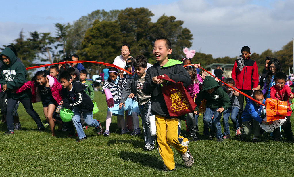 . Kids race to snatch up plastic Easter eggs at the annual San Leandro Easter egg hunt held at Marina Park in San Leandro, Calif., Saturday, April 12, 2014. The event has been held every year since 1951 and this year is sponsored by the San Leandro Optimist Club. 8,000 eggs with a candy or sticker surprise were given away. (Anda Chu/Bay Area News Group)