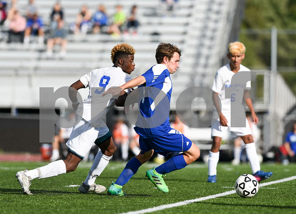 09/08/17 Wesley Bunnell   Staff Plainville Boys Soccer defeated visiting Bristol Eastern on Friday afternoon. Plainvilles Dane Stephens (9) and Bristol Easterns Tom Lombardi #5.