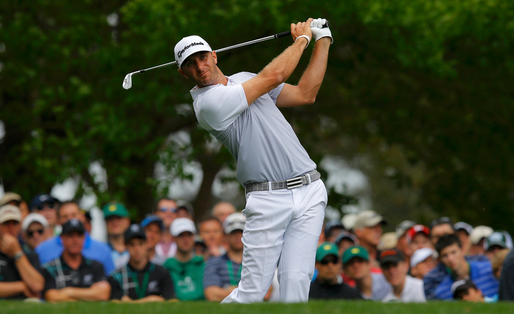 . Dustin Johnson of the U.S. hits his tee shot on the fourth hole during second round play in the 2013 Masters golf tournament at the Augusta National Golf Club in Augusta, Georgia, April 12, 2013.    REUTERS/Brian Snyder