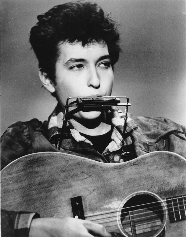. Folk singer and songwriter Bob Dylan plays the harmonica and acoustic guitar in March 1963 at an unknown location.  He was born in Duluth, Minnesota in 1941 as Robert Allen Zimmerman. (AP Photo)