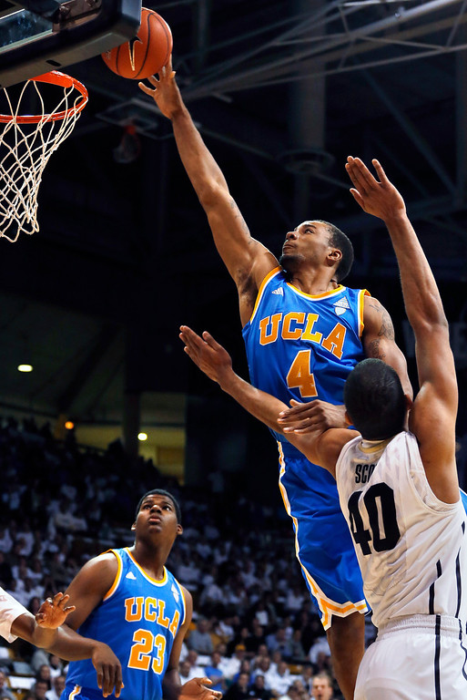 . UCLA\'s Norman Powell shoots as Colorado\'s Josh Scott defends during the first half of an NCAA college basketball game in Boulder, Colo., Thursday, Jan. 16, 2014. (AP Photo/Brennan Linsley)