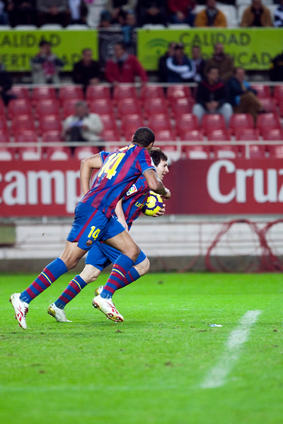Henry and Messi celebrate a goal. Spanish Cup game between Sevilla FC and FC Barcelona, Ramon Sanchez Pizjuan stadium, Seville, Spain, 13 January 2010